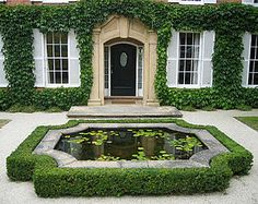 Traditional pond for country house setting; topiary frames this raised pond. Formal Gardens, Outdoor Gardens, Small Gardens, Raised Pond, Formal Garden Design, Boxwood Garden, Boxwood Hedge, Water Features In The Garden, Parcs