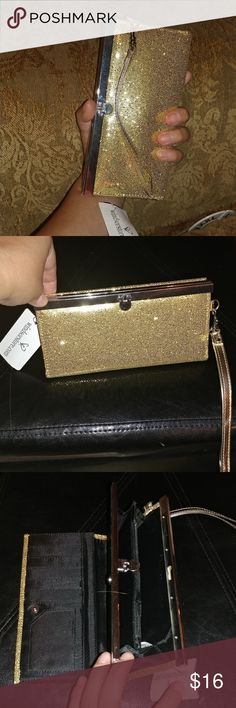 Wristlet wallet shinny gold from Windsor fashion Wristlet wallet shinny gold from Windsor fashion. For a night out or just an every day wallet  More than 10 credit card slots and coins holder in a dual compartment. New Windsor Bags Wallets
