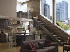 Rustic Living Room Decorating. awesome, love the open staircase & brick wall, however probably not a good idea for klutzy me