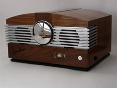 This is my tribute to the 1946 Stromberg Carlson model 1110H whose cabinet was designed and built by the Ingraham Cabinet Co. Ingraham is an aluminum Silverstone LC06 case clad with American black walnut. Features a 1.6 GHz VIA Nano CPU, 4GB of memory and a Crucial 64GB SSD. Ingraham debuted at the CES 2009 Showstoppers event.