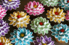 Dahlia cupcakes!! Cut marshmallows in half diagonally and dip in colored sugar.
