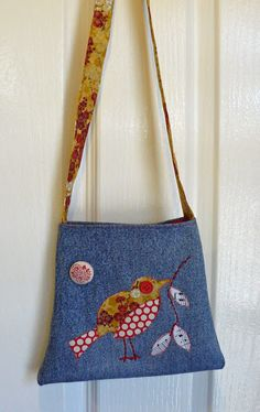 Recycled denim bag from pant leg.  Tapered.  No tutorial.  Just plain cute, and easy to figure out, if you've done any sewing.