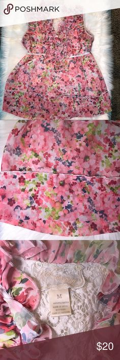 Nick & Mo floral top Nick & Mo floral sleeveless top. Beautiful lace backing. Excellent condition. No stains, rips or odors. Size Medium. Zips up size. Nick & Mo Tops Blouses