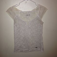 White Abercrombie and Fitch shirt Cream in color and also opaque, this is an xs but could also fit a small. Gorgeous white floral embroidery, only worn once or twice. Abercrombie & Fitch Tops Blouses