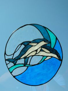 Dolphins jumping in wave stained glass window by windows2thesoul, $6.00