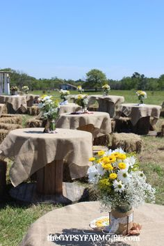 Mason jar centerpieces at a vintage farm wedding. Wooden spools were covered with burlap tableclothes and guest sat on hay bales. Farm Wedding, Wedding Table, Wedding Reception, Rustic Wedding, Dream Wedding, Wedding Ideas, Seating Arrangement Wedding, Wedding Arrangements, Flower Arrangement