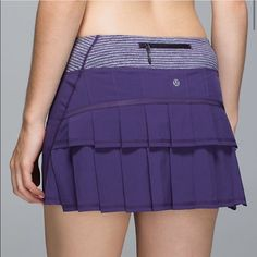 """Lululemon Pace Setter Purple Ruffle Skirt Adorable Lululemon Pace Setter Purple Ruffle Skirt! Has back zipper pocket & 2 hidden waistband pockets! Flat front with wee stripe waist! Love this look! Hidden shorts underneath! Size 12. Waist to hem is approximately 14.5"""" inches. Very good condition! lululemon athletica Skirts Mini"""