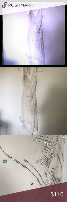 BCBG HALTER DRESS WITH FLORAL BEADED DESIGN Off white halter BCBG dress with silver floral beading design , high low cut , size 2 BCBGMaxAzria Dresses Asymmetrical