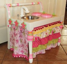 Play kitchen from a chair...such a cute idea. I will be looking for a thrift store chair to refurbish into this for Addi.