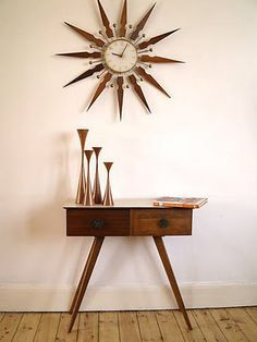 Midcentury modern console table and starburst clock.