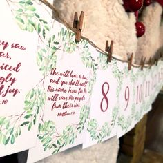 Free Printable Advent Calendar with Christmas Bible verses, calligraphy and watercolor wreathes. Print your own hanging calendar to count down to Christmas