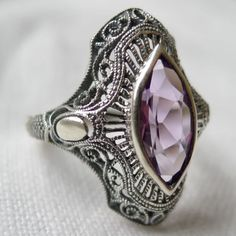 Love the detailing of shape and Art Deco style lines mixed with filigree.