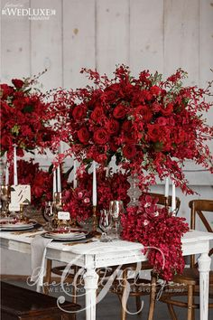 A rich, deep red autumn wedding centerpiece as featured in WedLuxe Magazine