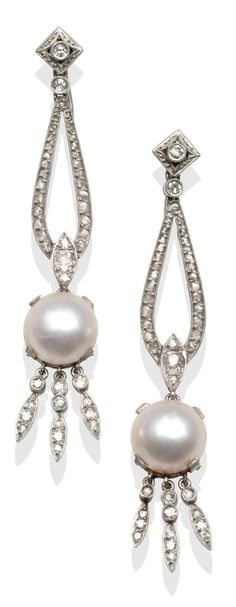 A Pair of Art Deco Diamond and Mother of Pearl Earrings, an old cut diamond stud in a diamond shaped frame suspends an articulated link inset with eight-cut diamonds to a diamond set pierced panel with a pearl-coated mother of pearl button and diamond set tassel drops, total estimated diamond weight 1.00 carat approximately, drop length 6.5cm, with screw fittings.