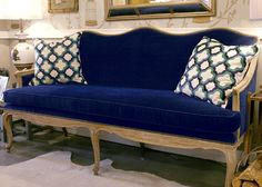 This reupholstered Settee in Navy Velvet with brass nail heads is a wonderful example of how a good frame is always work saving. From D.L.Rhein #dlrhein See another great before and after piece on the InsideSeen design blog: http://blog.fabricseen.com/fabricseen-finished-project-reupholstered-sofa/
