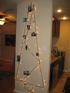 Christmas Tree Made Of Lights On Wall lights on wall in the shape of a tree and decorated for dorm room