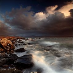angus clyne | Loch Gairloch | seascape landscape + ocean waves clouds sky rocks brown blue black white