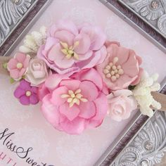 Organic paper flowers on a knit stretch headband, fits newborn to adult. Pretty combination of colors and sizes of flowers make this the perfect photo prop.