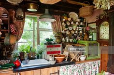English rustic country kitchen with china adorning every surface and a grandfather clock in the corner