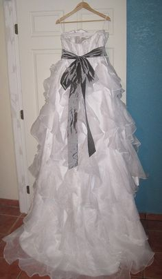For example, this dress is on sale as a used JH8962. I studied it, & I think it's a knockoff. The seller doesn't say that it is, but tell me what you think based on the real JH8962.   http://www.recycledbride.com/listing/wedding-dresses/jim-hjelm-jh8962-2    I think it is based on how the ruffles look under the flash. They look gossamar and thin. Also it's being sold for $500. The real dress is thousands more. I haven't seen a bride yet sell a preowned dress for thousands at this low.