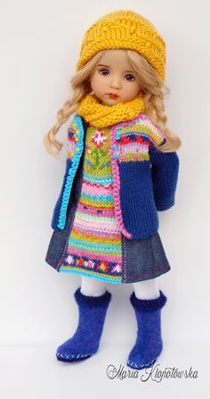 This outfit includes: *Hand knitted cardigan with multicolored intarsias on front. *Dress - hand knitted multicolored front of dress, sides and back are sewn of denim *Hand knitted yellow hat and chimney scarf *Hand felted boots *White footless stockings Knitted Dolls, Crochet Dolls, Crochet Hats, Pretty Dolls, Beautiful Dolls, Felt Boots, Gotz Dolls, Diana, Glitter Girl