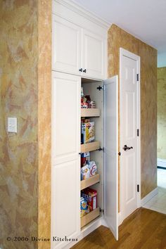 Another built-in pantry, drawers on wheels. Might have to try this.
