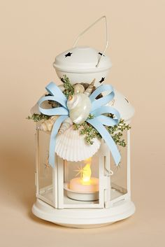 8 inch high White Metal Lantern with Removable Shell Collar, Light Blue Bow and Battery Tea Light