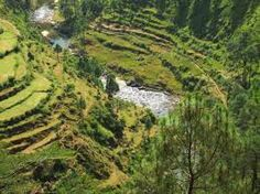 Kumaon (Hindi: कुमाऊं) or Kumaun is one of the two regions and administrative divisions of Uttarakhand, a mountainous state of northern India, the other being Garhwal. It includes the districts of Almora, Bageshwar, Champawat, Nainital, Pithoragarh, and Udham Singh Nagar. It is bounded on the north by Tibet, on the east by Nepal, on the south by the state of Uttar Pradesh, and on the west by the Garhwal region. The people of Kumaon are known as Kumaonis and speak the Kumaoni language.