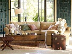 Meditteranean Living Room....warm wall color, rich pallette, matte walls, rich khaki, rustic table and seagrass.