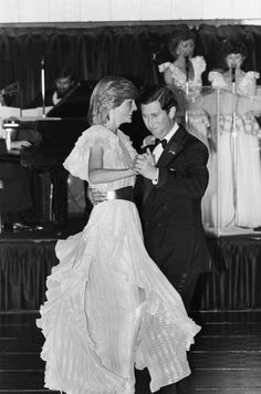 PRINCE CHARLES and PRINCESS DIANA dancing at a charity ball at the Wentworth Hotel in Sydney during their TOUR OF AUSTRALIA.  (1983)
