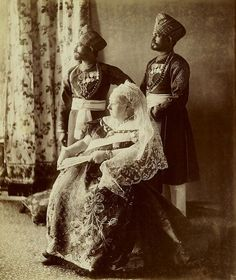 Queen Victoria with two Indian Servants