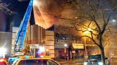 Fire crews are battling a big fire next to the Pix Theater in the City of Lapeer 11/12/2013