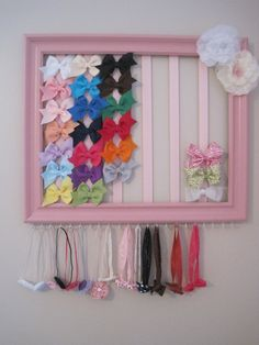 Hair bow and headband organizer. Made from a painted picture frame, hooks and ribbons.