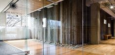 Lobby area utilizing reclaimed wood, mixed with modern elements. Barn wood and natural elements for commercial space