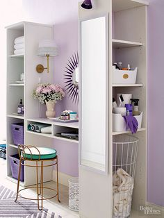 This bathroom dressing area turns down the volume by pairing pastel lavender walls with creamy woodwork and stone-tiled floors.