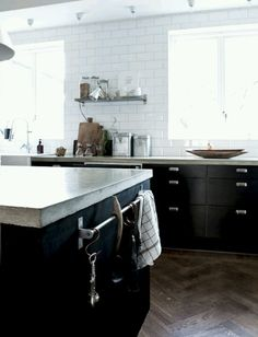 Concrete Countertop | Black Cabinets | White Subway Tile