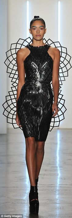 Taking wing:Chromat debuted several technologically-advanced pieces during its Fashion Week show on Friday, including thisChromat Adrenaline Dress that has wings that expand in reaction to adrenaline