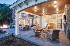 Lake House With a Classic Coastal Feel - Patio Layout. Interesting Patio Layout with fire pit, covered patio with fireplace and kitchen.