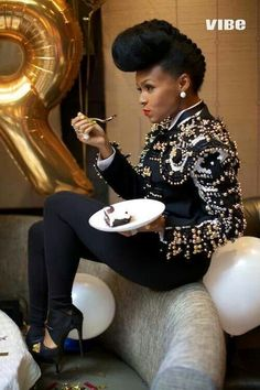 Janelle Monae..her hair..her wardrobe..her style. I love it all