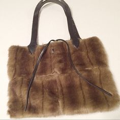 """BOGO free!  Faux Fur Purse Beautiful faux fur tote. Inside seams exposed for a rustic look. Vegan leather straps. Dimensions: 20"""" w X 12"""" h X 1"""" d. There is a 12 inch strap drop. Overall clean. Straps have threads popping out of fabric, but seam threads are in tact.  👗💫🌾👑 👗💫🌾👑. 👗💫🌾👑.  (Be sure to ask about our BOGO FREE offer!!  Look for details listing in closet!) Unknown Bags Totes"""