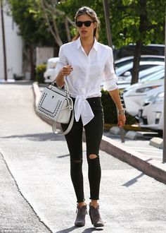 Stylish! The Victoria's Secret Angel went effortlessly chic in distressed denim jeans and a crisp white shirt