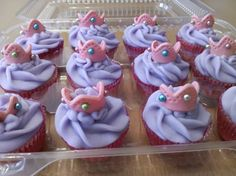 Use fondant or gum paste to make mini tiaras. Use silver balls for decoration, and purple icing
