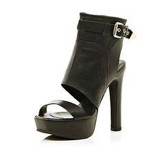 Black high vamp buckle platform heels