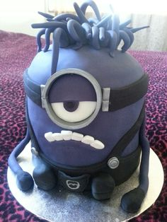Evil purple minion cake. Fondant covered chocolate cake with buttercream filling. Visit Becs Cakes on facebook ;)