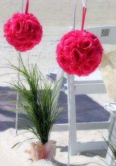 Hot pink pomanders line the aisle