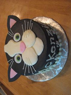 Cat cake...make this guy siamese with tan base and dark brown ears & nose/cheeks and bright blue eyes.