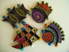 Felt and zipper brooches by Wooly Fabulous - going to try this with polymer clay