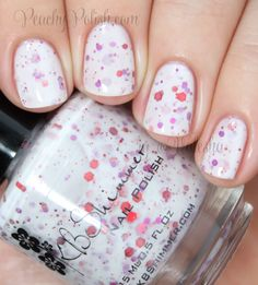 """""""Falling For Hue"""" has red, pink and fuchsia glitter in a white crelly base."""