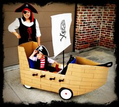 I can't take credit for this one.  My talented hubby put together this pirate ship for our son.  He turned his Radio Flyer wagon into an awesome pirate ship for Halloween...even with its own jolly roger flag. :o)