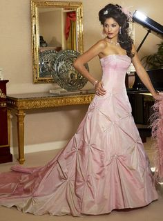 Fully colored wedding gown in pink made of taffeta features ruched skirt. A-line silhouette with strapless corset bodice looks flawless on ay body shape. Draped neckline adds touch of drama to the simple bodice. Chapel train. More colors available shown in Color Options. Custom-to-measurement for any sizes.